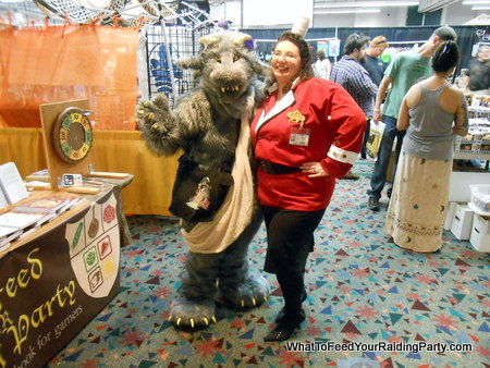 A cosplayer and myself--the furry one later came by to buy a book after the costume contest: hi Sam!